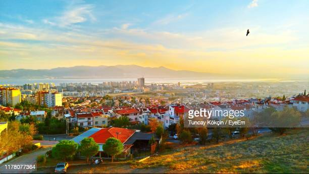 high angle view of townscape against sky at sunset - izmir stock pictures, royalty-free photos & images