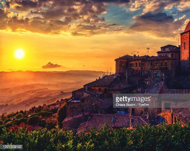 high angle view of townscape against sky at sunset - high dynamic range imaging stock pictures, royalty-free photos & images
