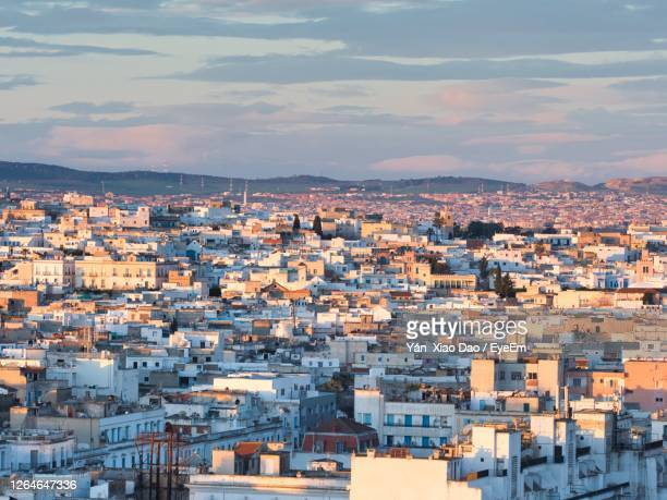 high angle view of townscape against sky at sunset - tunis stock pictures, royalty-free photos & images