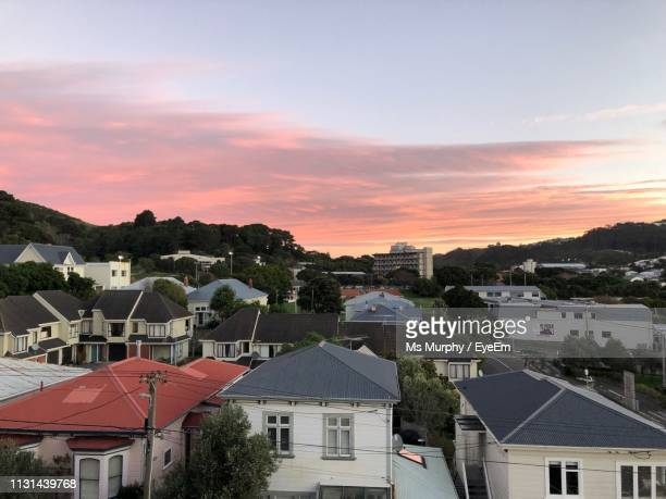 high angle view of townscape against sky during sunset - wellington new zealand stock pictures, royalty-free photos & images