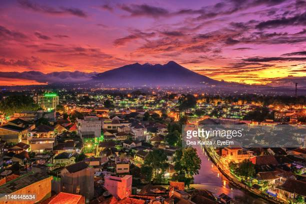 high angle view of townscape against sky during sunset - bogor stock pictures, royalty-free photos & images