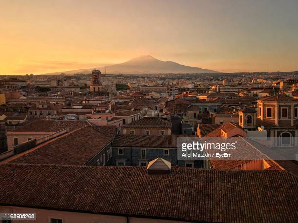 high angle view of townscape against sky during sunset - catania stock pictures, royalty-free photos & images