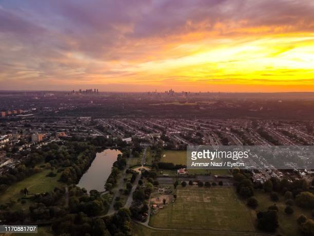 high angle view of townscape against sky during sunset - east stock pictures, royalty-free photos & images