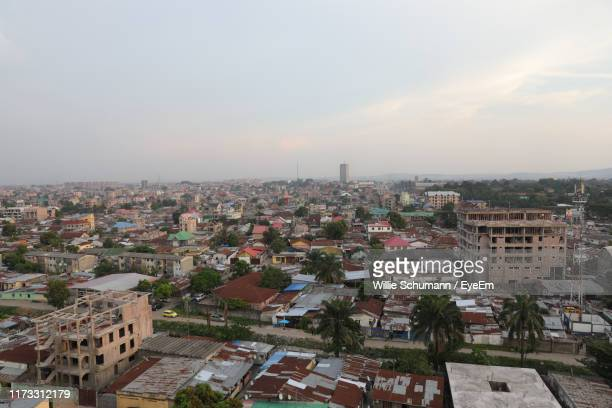 high angle view of townscape against sky during sunset - kinshasa stock-fotos und bilder