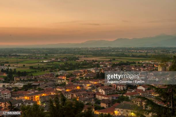 high angle view of townscape against sky during sunset - cuneo stock pictures, royalty-free photos & images