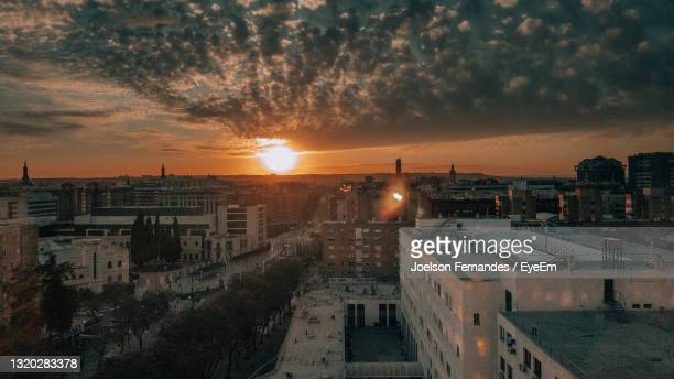 high angle view of townscape against sky during sunset - seville stockfoto's en -beelden