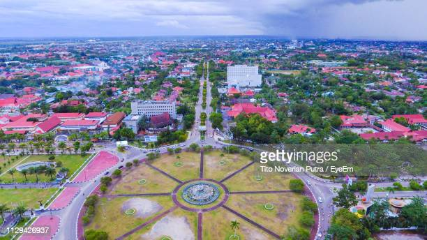 high angle view of townscape against sky in city - central kalimantan stock pictures, royalty-free photos & images