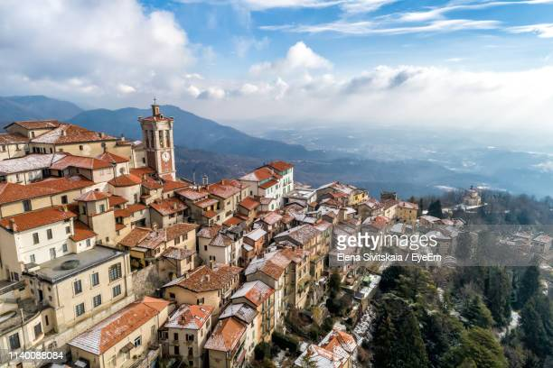 high angle view of townscape against sky in city - varese stock pictures, royalty-free photos & images