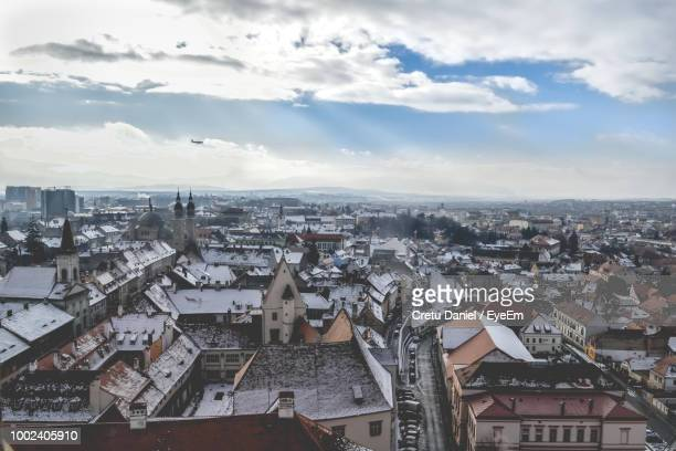 high angle view of townscape against sky - sibiu stock photos and pictures