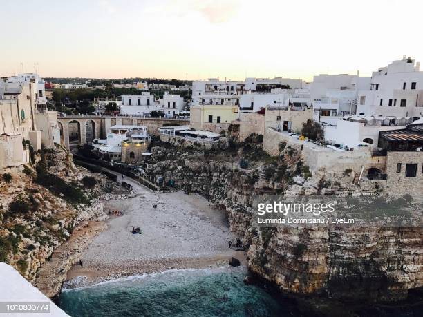 high angle view of townscape against sky - polignano a mare stock photos and pictures