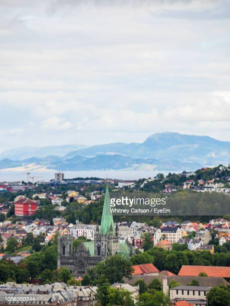 high angle view of townscape against sky - trondheim stock pictures, royalty-free photos & images