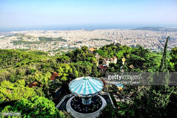 high angle view of townscape against sky - tibidabo stock pictures, royalty-free photos & images