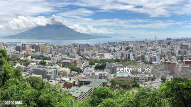 high angle view of townscape against sky - 鹿児島県 ストックフォトと画像