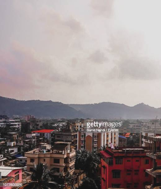 high angle view of townscape against sky - guwahati stock photos and pictures