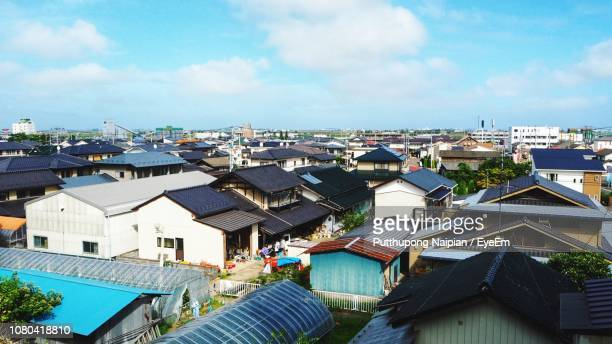 high angle view of townscape against sky - 住宅地 ストックフォトと画像