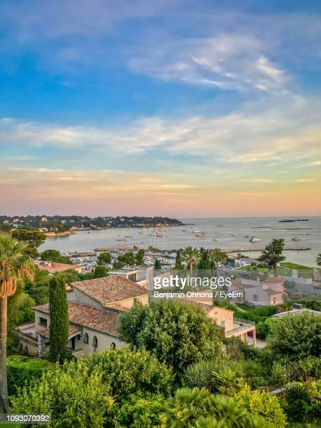 high angle view of townscape against sky - antibes stock photos and pictures