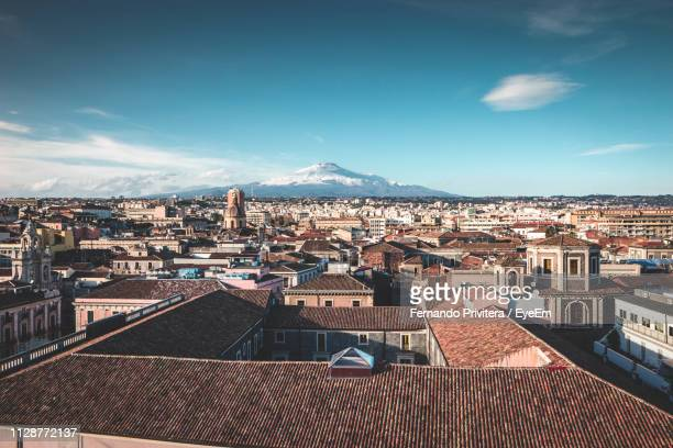 high angle view of townscape against sky - catania stock photos and pictures