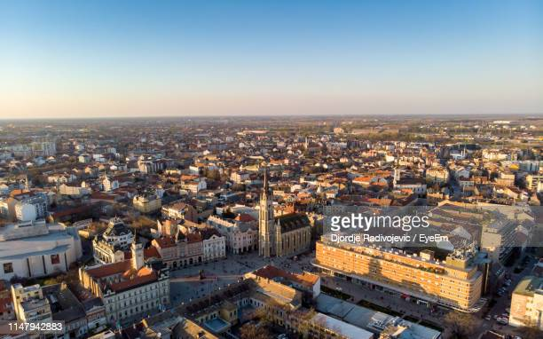 high angle view of townscape against sky - serbien stock-fotos und bilder