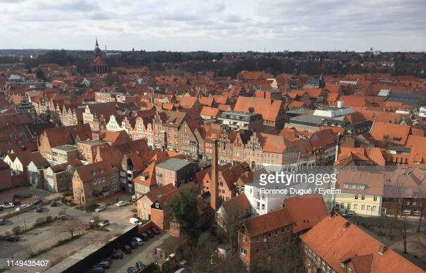 high angle view of townscape against sky - lüneburg stock photos and pictures