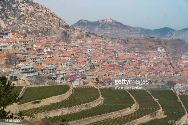 high angle view of townscape against sky - shandong province stock pictures, royalty-free photos & images
