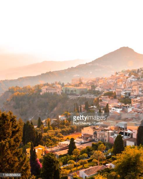 high angle view of townscape against sky - taormina stock pictures, royalty-free photos & images