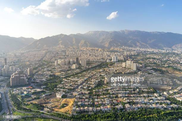 high angle view of townscape against sky - tehran stock pictures, royalty-free photos & images