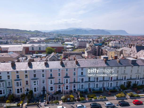 high angle view of townscape against sky - llandudno wales stock pictures, royalty-free photos & images