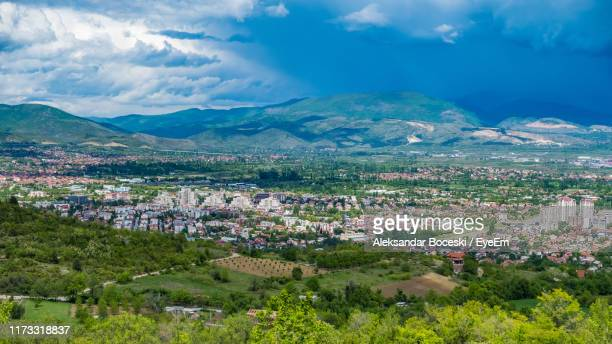 high angle view of townscape against sky - skopje stock pictures, royalty-free photos & images