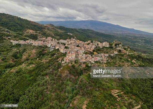 high angle view of townscape against sky - vista lateral stock pictures, royalty-free photos & images