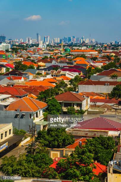 high angle view of townscape against sky - surabaya stock pictures, royalty-free photos & images
