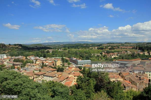 high angle view of townscape against sky - ulysses butterfly stock pictures, royalty-free photos & images