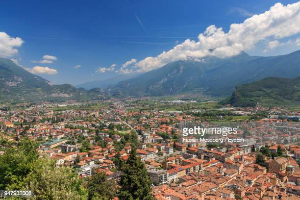 high angle view of townscape against sky - trento foto e immagini stock