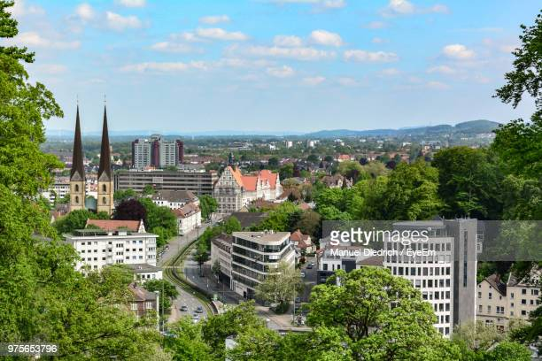 high angle view of townscape against sky - bielefeld stock pictures, royalty-free photos & images