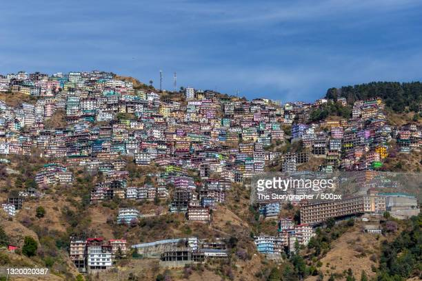high angle view of townscape against sky,shimla,himachal pradesh,india - the storygrapher ストックフォトと画像