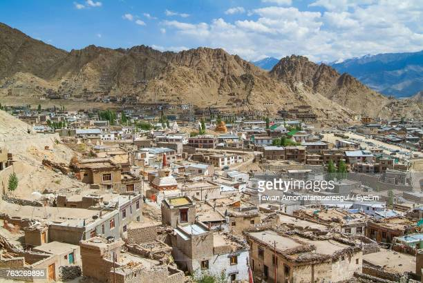 high angle view of townscape amidst mountain during sunny day - kashmir stock photos and pictures