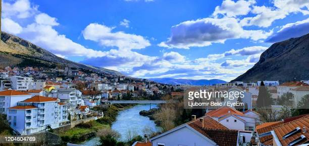 high angle view of townscape and buildings against sky - ljubomir belic stock pictures, royalty-free photos & images