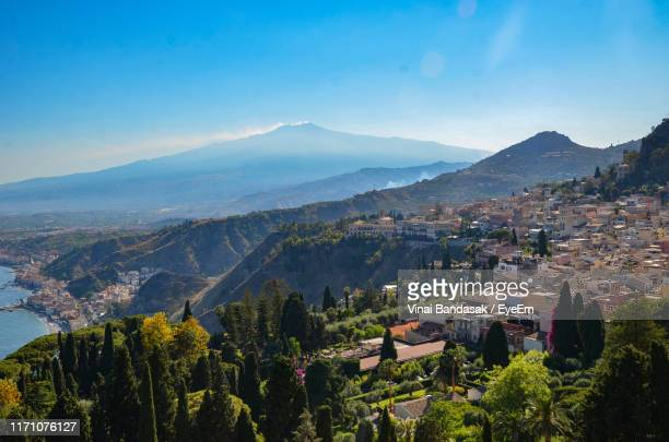 high angle view of townscape and mountains against sky - catania stock pictures, royalty-free photos & images