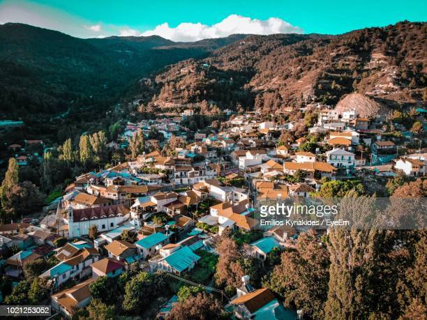 high angle view of townscape and mountains - república de chipre fotografías e imágenes de stock