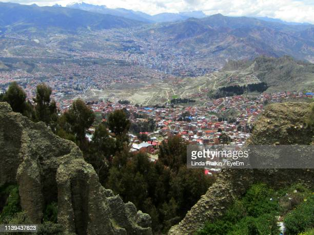 high angle view of townscape and mountains - linda fraikin stock pictures, royalty-free photos & images
