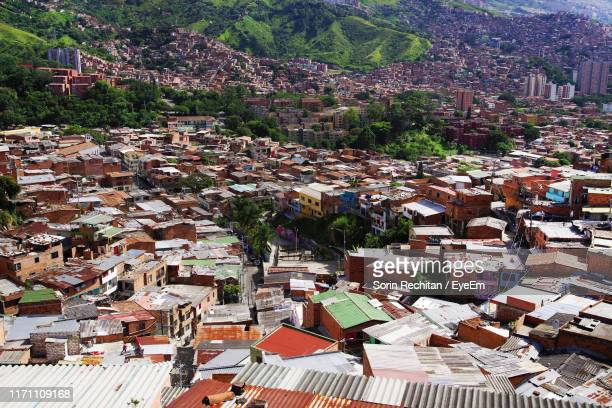 high angle view of townscape and mountains - medellin colombia fotografías e imágenes de stock