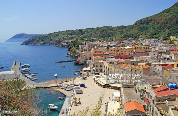 high angle view of townscape and sea against clear sky - insel lipari stock-fotos und bilder