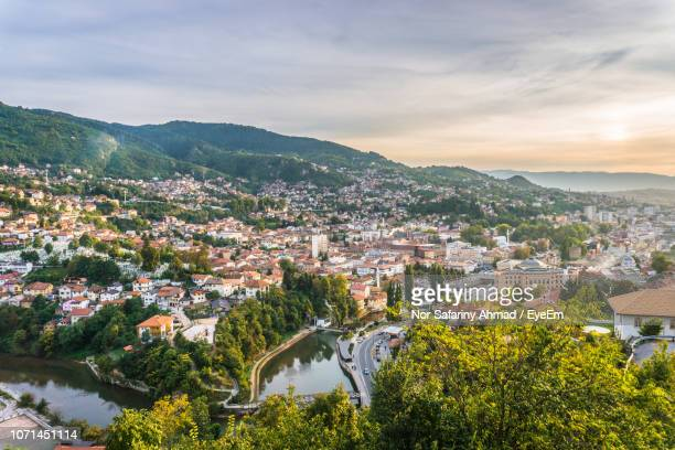 high angle view of townscape and trees against sky - sarajevo stock pictures, royalty-free photos & images