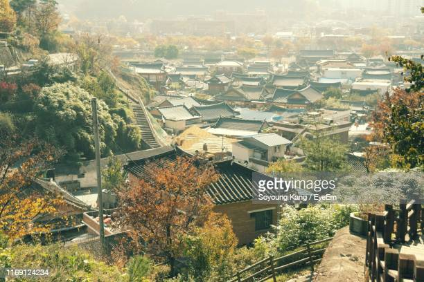 high angle view of townscape and trees in city - jeonju stock pictures, royalty-free photos & images
