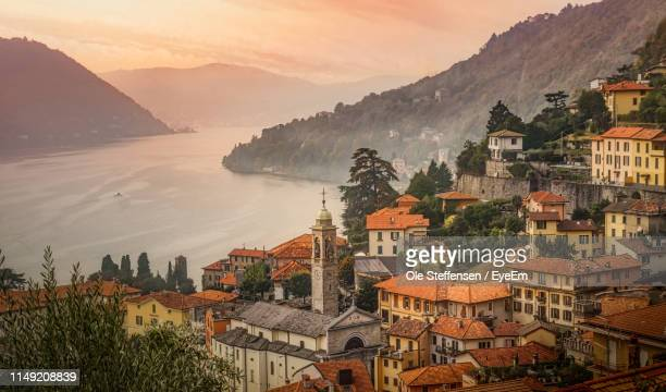 high angle view of townscape by mountain against sky - como italy stock pictures, royalty-free photos & images