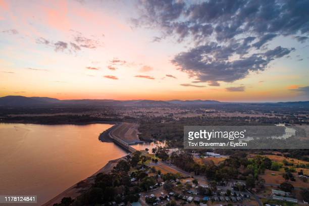 high angle view of townscape by river against sky during sunset - new south wales stock pictures, royalty-free photos & images