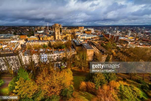 high angle view of townscape by river against sky - bristol england stock pictures, royalty-free photos & images