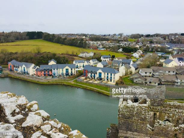 high angle view of townscape by river against sky - cardiff galles foto e immagini stock