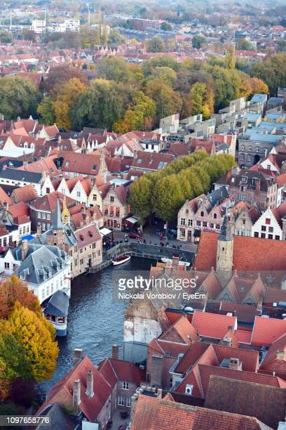 high angle view of townscape by river in city - bruges stock pictures, royalty-free photos & images