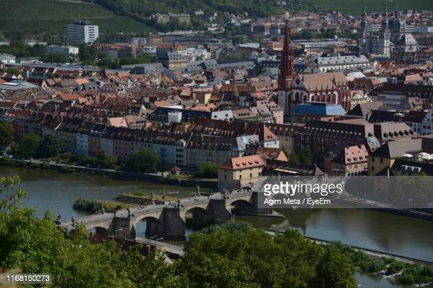 high angle view of townscape by river in city - agim meta stock-fotos und bilder
