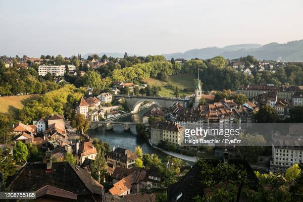 high angle view of townscape by river in city - bern stock pictures, royalty-free photos & images